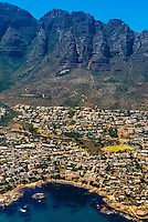 Aerial view of coastal road in Cape Town with Twelve Apostles in background, South Africa.