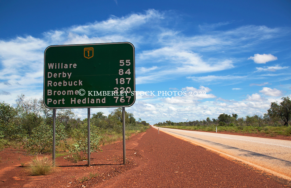 A road sign giving distances on the main highway between Broome and Derby in the Kimberley wet season.