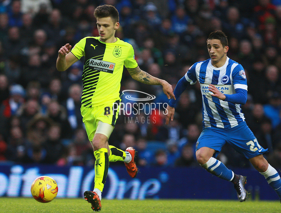 Huddersfield Town midfielder Jamie Paterson gets the better of Brighton central midfielder Beram Kayal during the Sky Bet Championship match between Brighton and Hove Albion and Huddersfield Town at the American Express Community Stadium, Brighton and Hove, England on 23 January 2016. Photo by Bennett Dean.