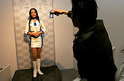 Japanese visitor photographing the humanoid robot that helps with the presentation of the robot shows incide the robot station at the AICHI WORLD EXPO 2005,. This robot is same as the Reception Robot from ACTROID (Advanced Media, Inc., and Kokoro Co., Ltd.)  Nagoya 4-April-2005, Japan