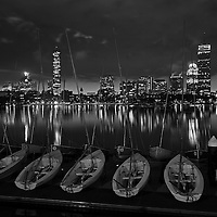 Boston B&W photography of the Charles River featuring famous landmarks such as the Prudential Center and John Hancock Tower. <br />
