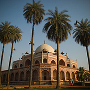 A couple enjoys an afternoon walk at the Humayun Tomb in New Delhi
