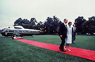 President and First Lady Ford walk away from Marine One with President Richard Nixon on board after Nixon resigned in August 1974.  ..Photograph by Dennis Brack BBBs 20