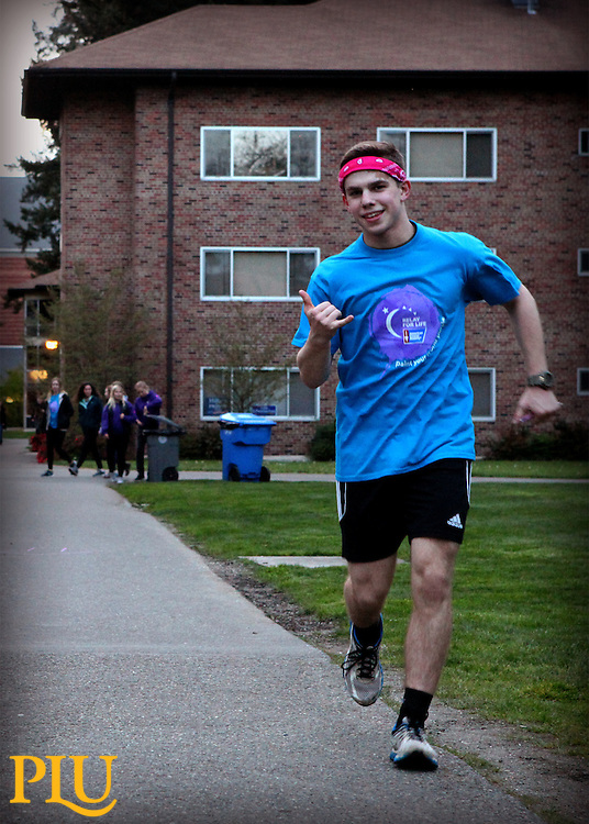 A cross cultural blend of Pacific Lutheran University students and staff, as well as cancer survivors including their loved ones participate in the 2016 Relay For Life at PLU, on Friday, April 15, 2016. Relay For Life, of the American Cancer Society, has become a global occasion in which funds are raised within communities to improve cancer survival, decrease the incidence of cancer, and improve the quality of life for cancer patients. (Photo: Robert R. Carrasco/PLU)