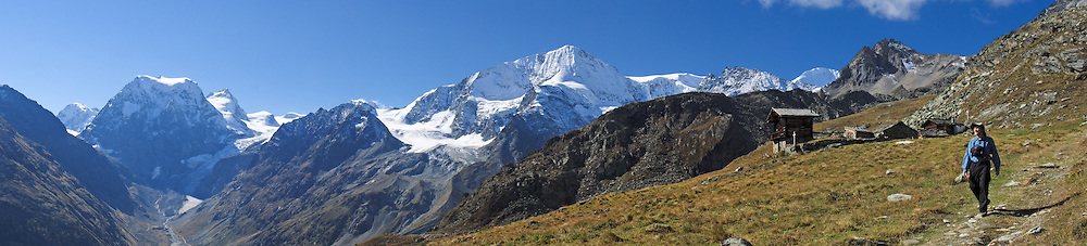 From Alp Pra Gra, see Mont Collon (left 3637 meters or 11,932 feet) at the head of Val d'Hérens, above Arolla village, municipality of Evolène, Valais (or Wallis) canton, Switzerland, on the High Route (Chamonix-Zermatt Haute Route), in the Pennine Alps, Europe. Panorama stitched from 5 overlapping images. Photo published 2010 by gfscom.ch on Swiss cheese packaging in Asia and Dubai.