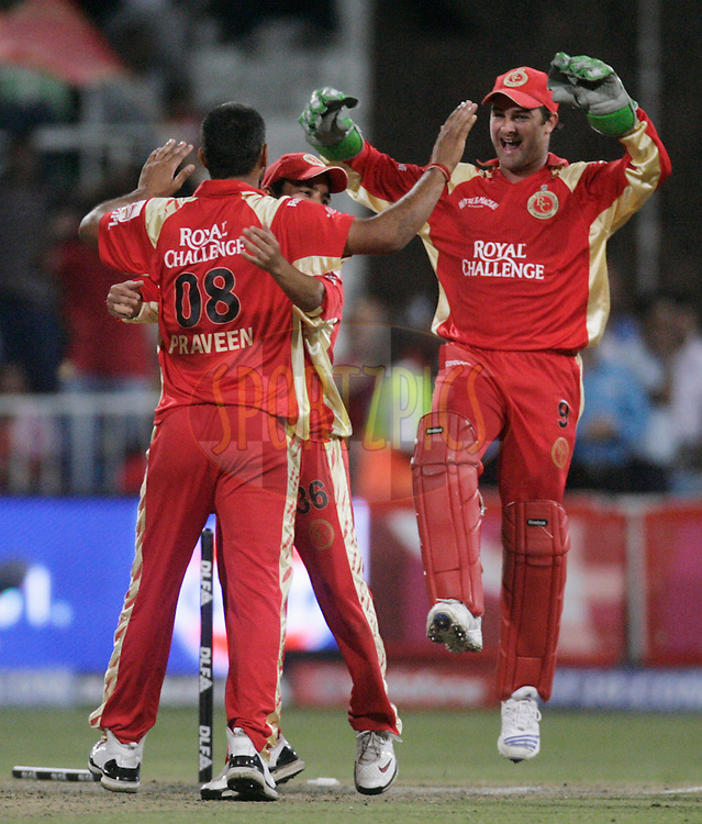 DURBAN, SOUTH AFRICA - 1 May 2009. Praveen Kumar, Sreevats Goswami and Mark Boucher celebrate during the IPL Season 2 match between Kings X1 Punjab and the Royal Challengers Bangalore held at Sahara Stadium Kingsmead, Durban, South Africa...