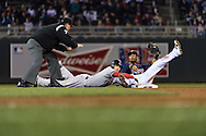 Stephen Drew #7 of the Boston Red Sox is called safe at 2nd base by umpire Chad Fairchild despite the protest by Pedro Florimon #25 of the Minnesota Twins on May 17, 2013 at Target Field in Minneapolis, Minnesota.  The Red Sox defeated the Twins 3 to 2.  Photo: Ben Krause