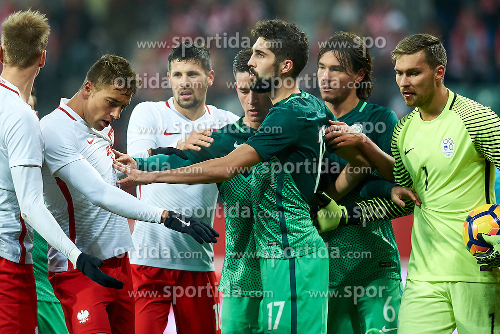 Wroclaw, Poland - 2016 November 14: Miha Mevlja of Slovenia speaks with Polish players during Poland v Slovenia - International Friendly Soccer Match at Municipal Stadium on November 14, 2016 in Wroclaw, Poland.<br /> <br /> Adam Nurkiewicz declares that he has no rights to the image of people at the photographs of his authorship.<br /> <br /> Picture also available in RAW (NEF) or TIFF format on special request.<br /> <br /> Any editorial, commercial or promotional use requires written permission from the author of image.<br /> <br /> Mandatory credit:<br /> Photo by © Adam Nurkiewicz / Mediasport