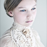 Close up of young girl wearing lace