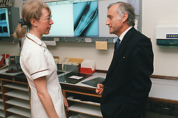 Female radiographer discussing Xray with man,
