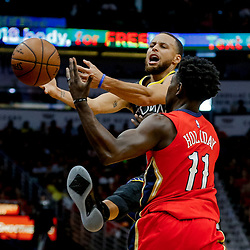 May 6, 2018; New Orleans, LA, USA; Golden State Warriors guard Stephen Curry (30) loses the ball as New Orleans Pelicans guard Jrue Holiday (11) defends during the first quarter in game four of the second round of the 2018 NBA Playoffs at the Smoothie King Center. Mandatory Credit: Derick E. Hingle-USA TODAY Sports