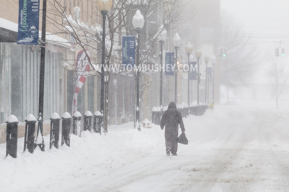 Middletown, New York - A man walks down North Street during a snowstorm on Feb. 9, 2017.