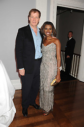 ALASTAIR CAMPBELL and JUNE SARPONG at the launch of Politics and The City - a new web site for women fusing politics with gossip, entertainment, news and fashion, held at the ICA, 12 Carlton House Terrace, London on 8th July 2008.<br />
