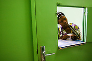 Konaté Fatouma waits to purchase drugs at the pharmacy of the NDA health center in Dimbokro, Cote d'Ivoire on Friday June 19, 2009..