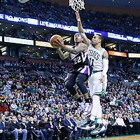 30 January 2013: Sacramento Kings point guard Isaiah Thomas (22) goes for the layup past Boston Celtics shooting guard Courtney Lee (11) during the Boston Celtics 99-81 victory over the Sacramento Kings at the TD Garden, Boston, Massachusetts, USA.