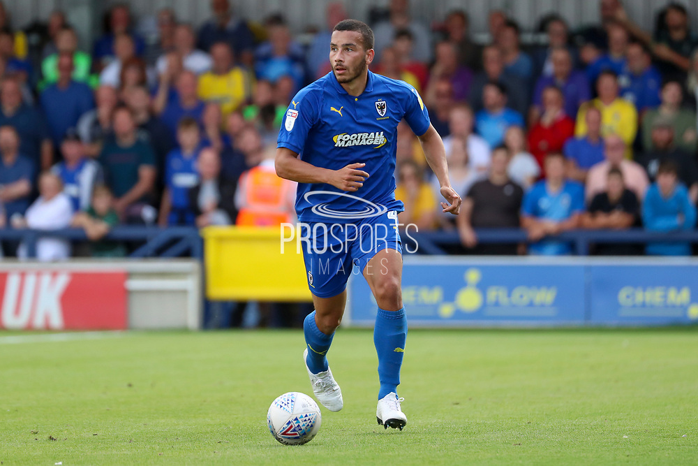 AFC Wimbledon defender Rod McDonald (4) dribbling during the EFL Sky Bet League 1 match between AFC Wimbledon and Accrington Stanley at the Cherry Red Records Stadium, Kingston, England on 17 August 2019.