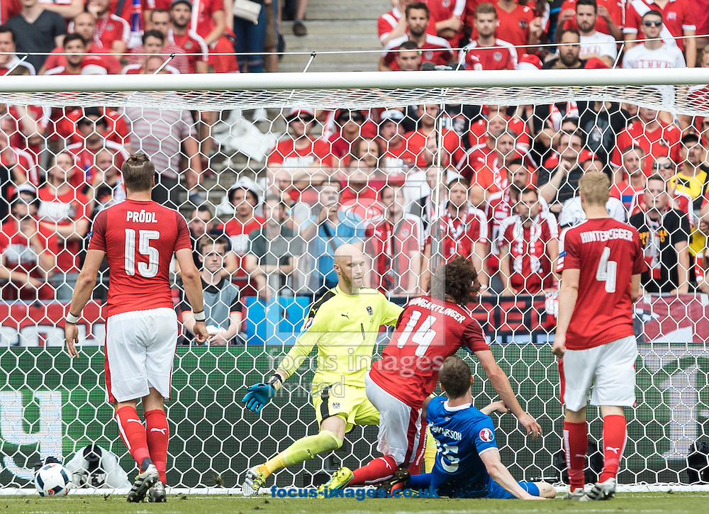 Dadi Boedvarsson of Iceland scores to make it 1-0 during the UEFA Euro 2016 match at Stade Velodrome, Marseille, France.<br /> Picture by EXPA Pictures/Focus Images Ltd 07814482222<br /> 22/06/2016<br /> *** UK &amp; IRELAND ONLY ***<br /> EXPA-FEI-160622-5025.jpg