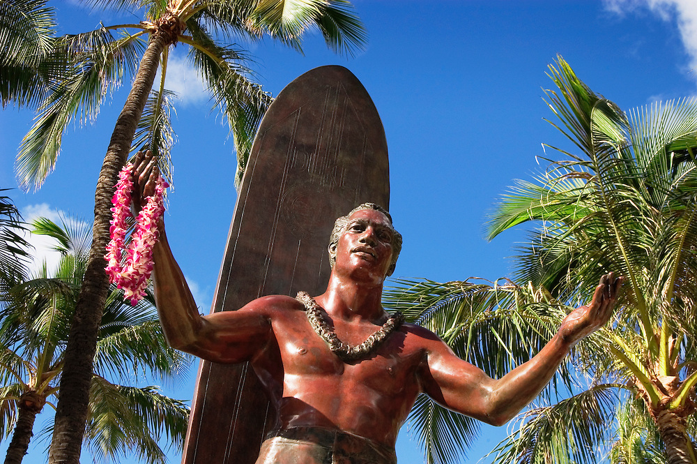 Duke Kahanamoku statue at Kuhio Beach Park on Waikiki Beach;  Honolulu, Oahu, Hawaii.