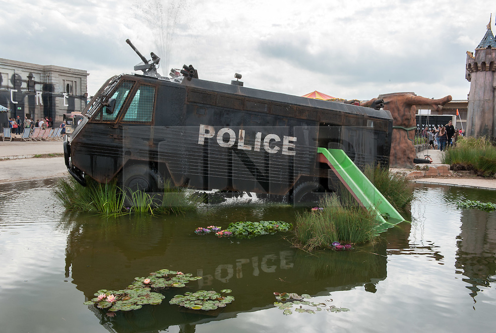 © Licensed to London News Pictures. 22/08/2015. Weston-super-Mare, North Somerset, UK.  A police water cannon with a children's slide in a pond on the first main day of BANKSY's Dismaland show at the old Tropicana on Weston seafront, when the event is open to the general public. Photo credit : Simon Chapman/LNP