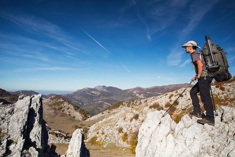 Hiker (Dan Dinu) on limestone ridge in Mehedinti Plateau Geopark, Geoparcul Platoul Mehedinți, Romania.