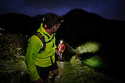 Night running at Haweswater, Lake District. Editorial outdoor sports and action image illustrating fell running with new generation LED head torches.