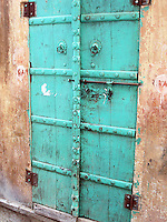 Weathered green door, Bagru, Rajasthan, India.