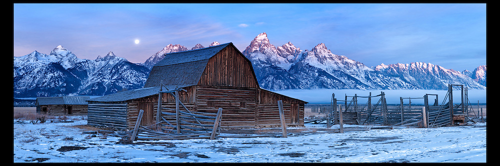 Moon setting along Mormon Row as the first hints of the morning sun hits the top of the Grand in Grand Teton National Park.