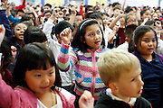Thy Pham (7) celebrates with the Zanker student body during the KLA-Tencor Computer Lab opening ceremony at Zanker Elementary School in Milpitas, California, on February 27, 2013. (Stan Olszewski/SOSKIphoto)
