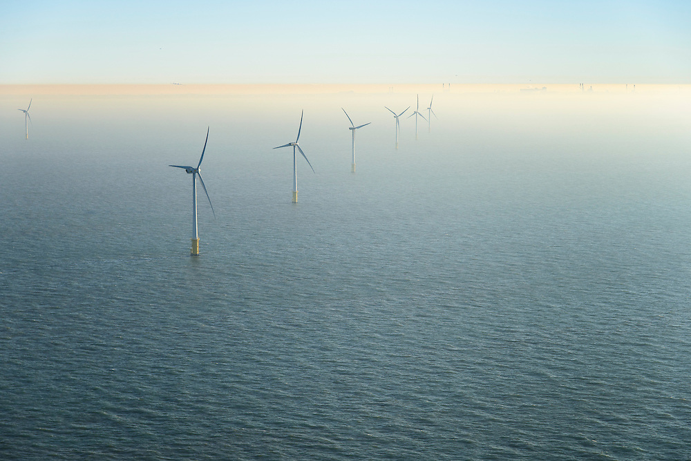 Nederland, Noord-Holland, IJmuiden, 11-12-2013; offshore Prinses Amaliawindpark telt 60 windturbines en is gebouwd door Eneco en Econcern. Het windmolenpark ligt 23 km uit de kust bij IJmuiden (blok Q7 van het Nederlands continentaal plat). Foto richting kust (Wijk aan Zee en Hoogovens / Corus aan de horizon).<br /> The Princess Amalia offshore Wind Farm consists of 60 wind turbines and is located in block Q7 of the Dutch Continental Shelf, 23 km from the shore.<br /> luchtfoto (toeslag op standaard tarieven);<br /> aerial photo (additional fee required);<br /> copyright foto/photo Siebe Swart.