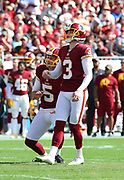 Nov 11, 2018; Tampa, FL USA: Washington Redskins kicker Dustin Hopkins (3) kicks a field goal in the first quarter of play against the Tampa Bay Buccaneers at Raymond James Stadium. The Redskins beat the Buccaneers 16-3. (Steve Jacobson/Image of Sport)