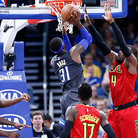 25 February 2017: Orlando Magic forward Terrence Ross (31) goes for the dunk against Atlanta Hawks forward Paul Millsap (4) during the Orlando Magic 105-86 victory over the Atlanta Hawks, at the Amway Center, Orlando, Florida, USA.