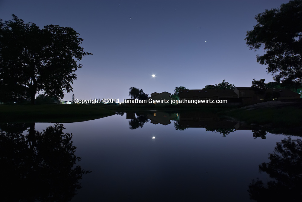 Houses along a golf-course pond at night, Davie, Florida. WATERMARKS WILL NOT APPEAR ON PRINTS OR LICENSED IMAGES.