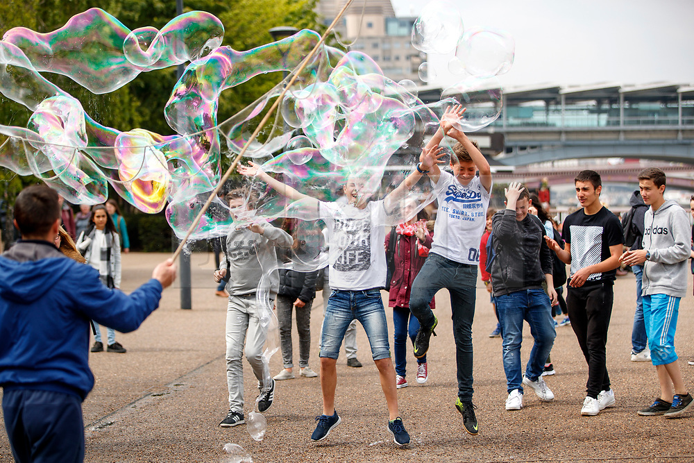© Licensed to London News Pictures. 11/05/2017. London, UK. Children pop water bubbles and enjoy warm weather and sunshine in Southbank, London on 11 May 2017 as temperatures hit 22C in central London. Photo credit: Tolga Akmen/LNP