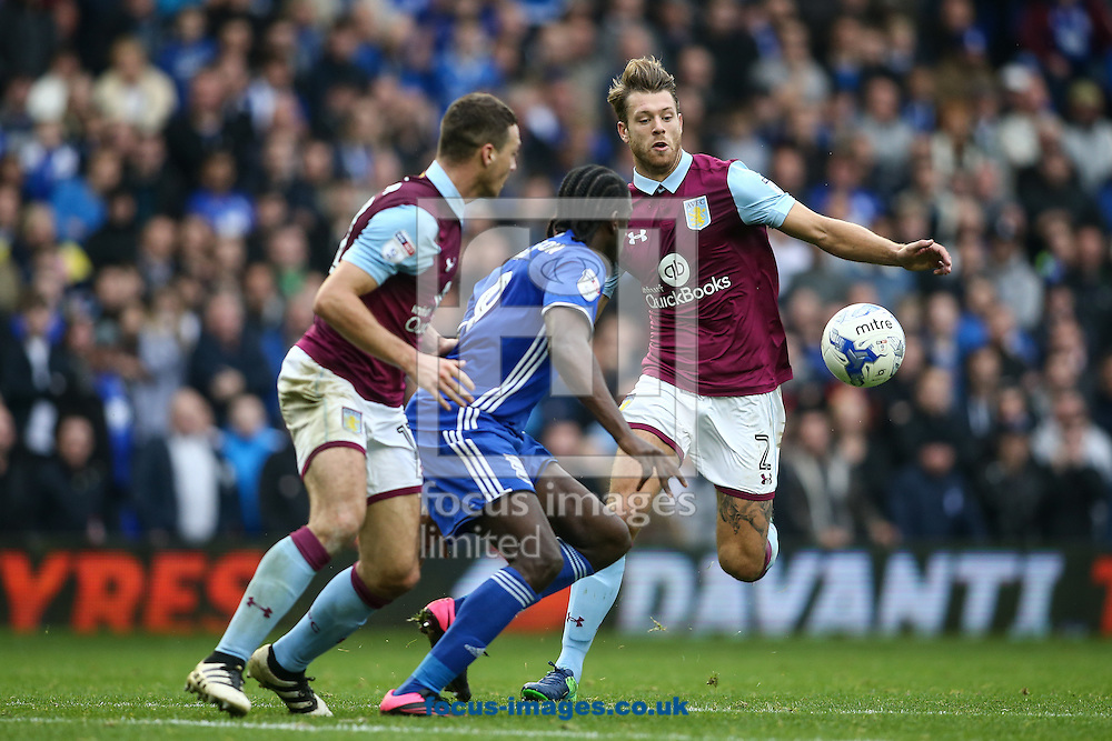 Nathan Baker of Aston Villa (right) competing with Clayton Donaldson of Birmingham City (centre) during the Sky Bet Championship match at St Andrews, Birmingham<br /> Picture by Andy Kearns/Focus Images Ltd 0781 864 4264<br /> 30/10/2016