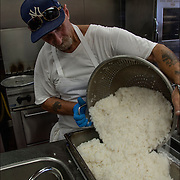 Homeless Soap Kitchen in Atlantic City. cook preparing rice in advance. <br /> <br /> The Kitchen was founded by a former casino chef, Jean Webster, 74, found her calling when she saw a man rummaging through a garbage can in search of food.