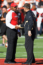 September 20, 2010; San Francisco, CA, USA;  San Francisco 49ers head coach Mike Singletary (left) shakes hands with New Orleans Saints head coach Sean Payton (right) before the game at Candlestick Park.