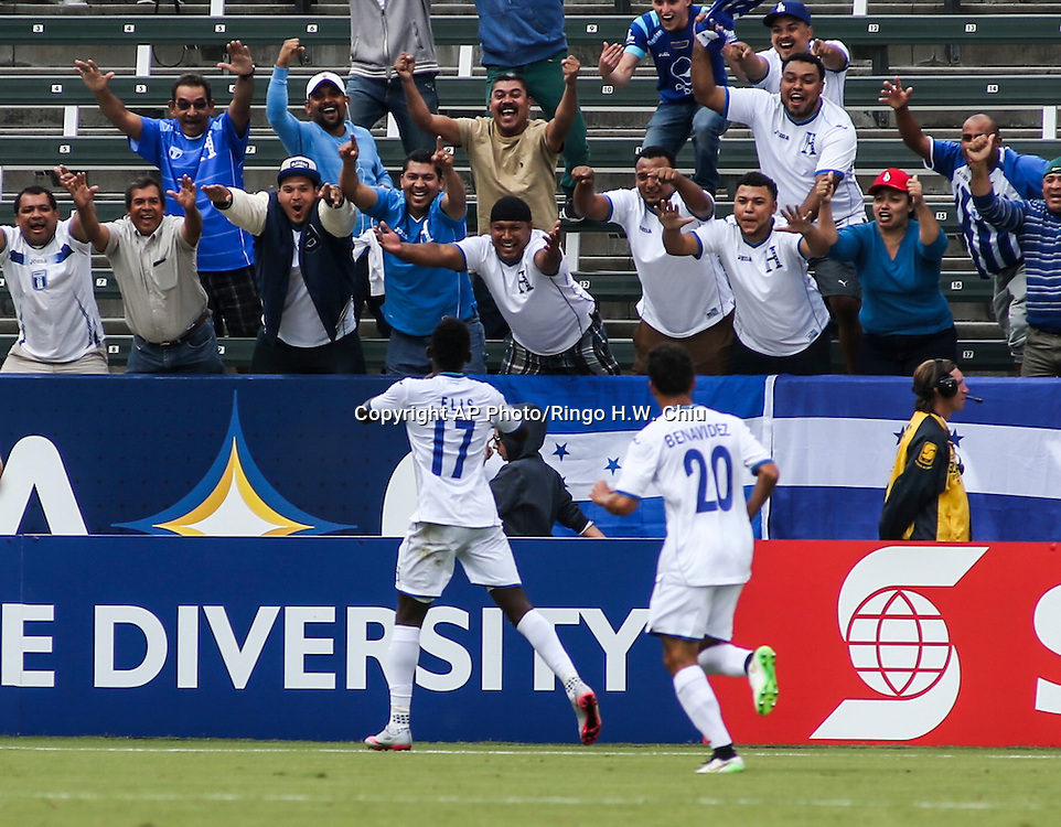 Honduras forward Alberth Josue Elis Martínez #17, cheers with the fans after his goal against Costa Rica in the second half of a CONCACAF men's Olympic qualifying soccer match in Carson, Calif., Sunday, Oct. 4, 2015. Honduras won 2-0. (AP Photo/Ringo H.W. Chiu)