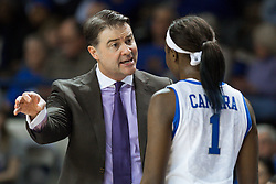 Kentucky head coach Matthew Mitchell, left, talks with forward Batouly Camara before the second half began.<br /> <br /> The University of Kentucky hosted the University of Tennessee, Monday, Jan. 25, 2016 at Memorial Coliseum in Lexington .