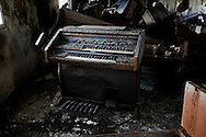 An electric organ, covered in dried silt, sits in a flood devastated Church in New Orleans' Lower 9th Ward..The organ is the center piece of most churches in Louisiana. Many of New Orleans' greatest musicians started their careers playing in their local churches..