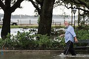 A man wades through flood waters in White Point Gardens in historic downtown after Hurricane Matthew passed through causing flooding and light damage to the area October 8, 2016 in Charleston, South Carolina. The hurricane made landfall near Charleston as a Category 2 storm but quickly diminished as it moved north.
