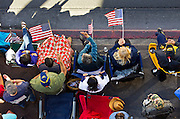 Flags are waved for participants in the Veteran's Day Parade running along S. 4th Street in Downtown Las Vegas on Tuesday, November 11, 2014. L.E. Baskow
