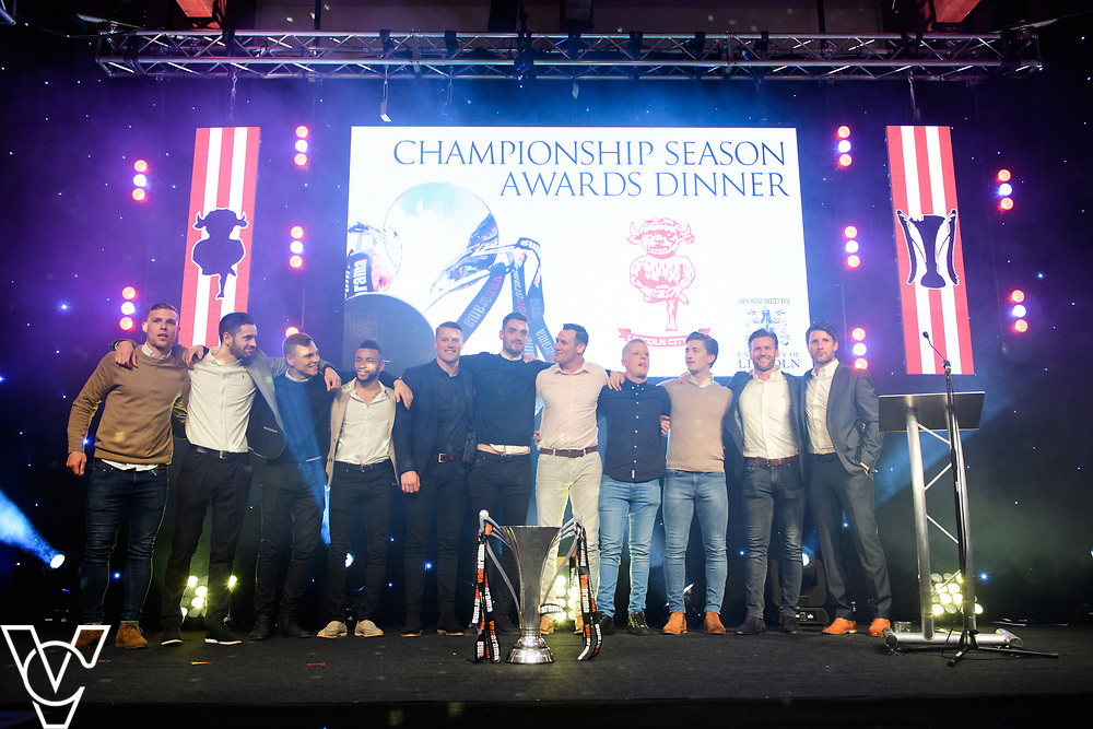 Lincoln City Football Club's 2016/17 End of Season Awards night - Championship Seasons Awards Dinner - held at the Lincolnshire Showground.<br /> <br /> Lincoln City players and management staff on stage with the Vanarama National League Trophy<br /> <br /> Picture: Chris Vaughan Photography for Lincoln City Football Club<br /> Date: May 20, 2017