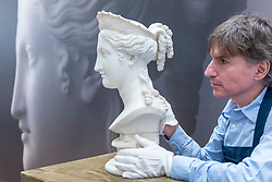 "© Licensed to London News Pictures. 29/06/2018. LONDON, UK. A staff member presents ""Bust of Peace"" by Antonio Canova (Est. in excess of £1m).  Preview of Old Masters, British, Treasures, Sculptures and Ancient works at Sotheby's New Bond Street to be offered for sale on 3 and 4 July 2018.  Photo credit: Stephen Chung/LNP"
