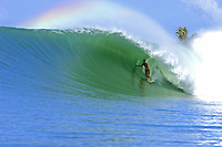Surfing a perfect wave at Lagundri Bay, Nias Island, Sumatra, Indonesia