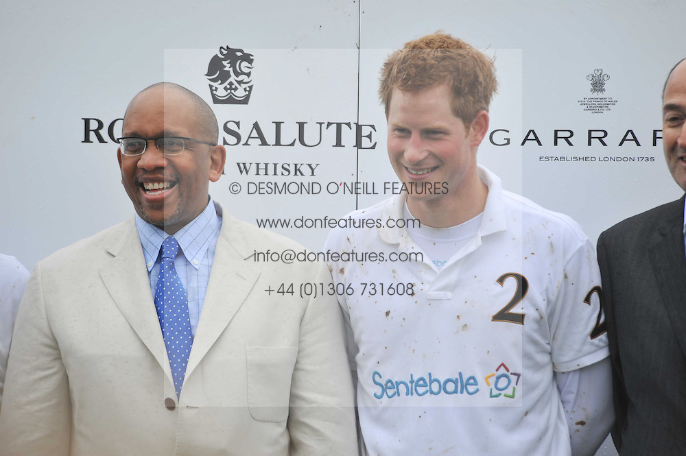 Left to right, PRINCE SEEISO OF LESOTHO and HRH PRINCE HARRY at the Sentebale Polo Cup held at Coworth Park, Berkshire on 12th June 2011.