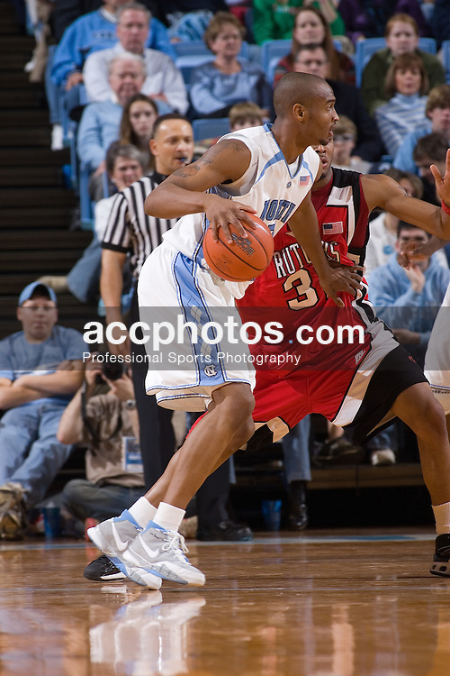 28 December 2006: North Carolina Tarheel forward (3) Reyshawn Terry fends off Rutgers guard (3) Courtney Nelson during a 87-48 Rutgers Scarlet Knights loss to the North Carolina Tarheels, in the Dean Smith Center in Chapel Hill, NC.<br />