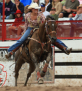 Professional Women's Barrel Racer Whitney Baker of Stephenville, TX clears the barrels in a quick 18.10 seconds, 27 July 2007, Cheyenne Frontier Days