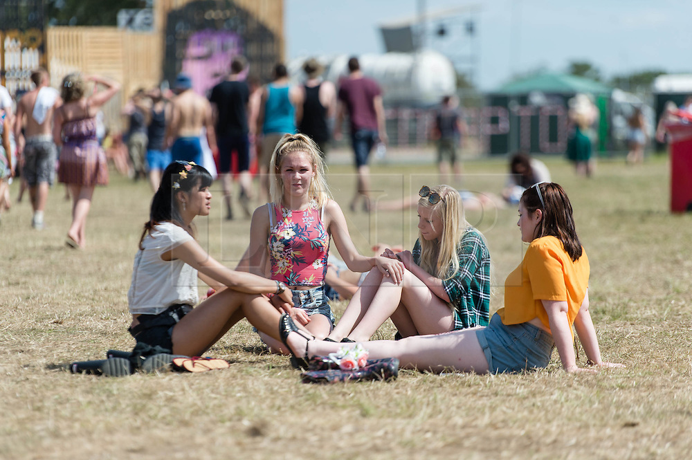 © Licensed to London News Pictures. 13/06/2014. Isle of Wight, UK.  Festival goers  enjoy the hot morning sun at the Isle of Wight Festival 2014.   Today is expected to be the hottest day of the year.  The Isle of Wight festival is an annual music festival that takes place on the Isle of Wight. Photo credit : Richard Isaac/LNP