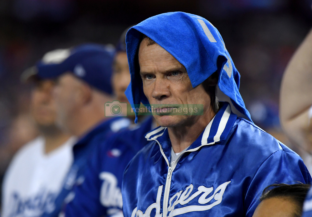November 1, 2017 - Los Angeles, CA, USA - Red Hot Chili Peppers Flea wears a rally towel on his head in the 8th inning of game seven of a World Series baseball game at Dodger Stadium on Wednesday Nov. 1, 2017 in Los Angeles. (Credit Image: © Keith Birmingham/Los Angeles Daily News via ZUMA Wire)