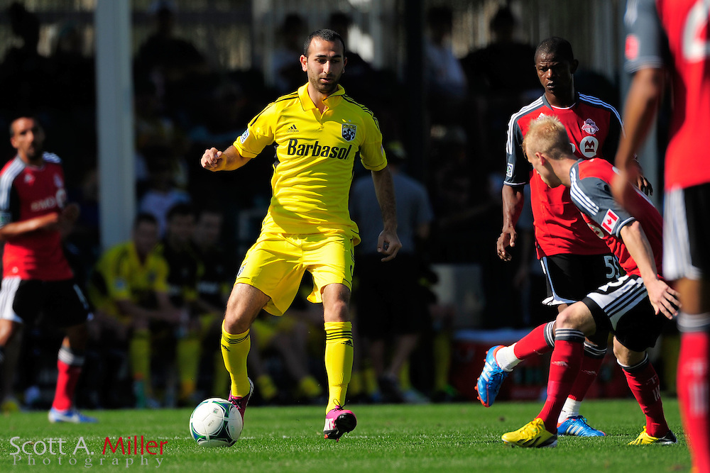 Columbus Crew forward Justin Meram (9) during the Disney Pro Soccer Classic on Feb 9, 2013  in Lake Beuna Vista, Florida. ..©2013 Scott A. Miller